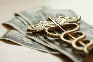 dollars and caduceus